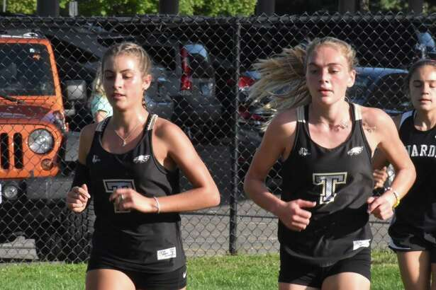 Trumbull seniors Alessandra Zaffina and Emily Alexandru led the Eagles to an FCIAC quad-meet sweep on Tuesday.