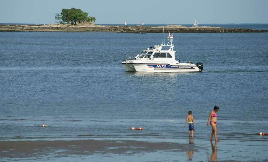 A Stamford Police Marine Division boat passes West Beach in Stamford, Conn., in this file photo. Photo: Lindsay Perry / Lindsay Perry / Stamford Advocate
