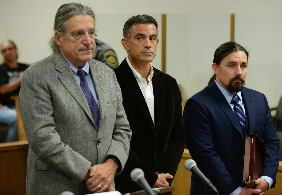 Fotis Dulos, center, appears with his attorneys Norm Pattis, left, and Kevin Smith, right, for arraignment on a new tampering with evidence charge Thursday, Sept. 12, 2019, at state Superior Court in Norwalk, Conn.