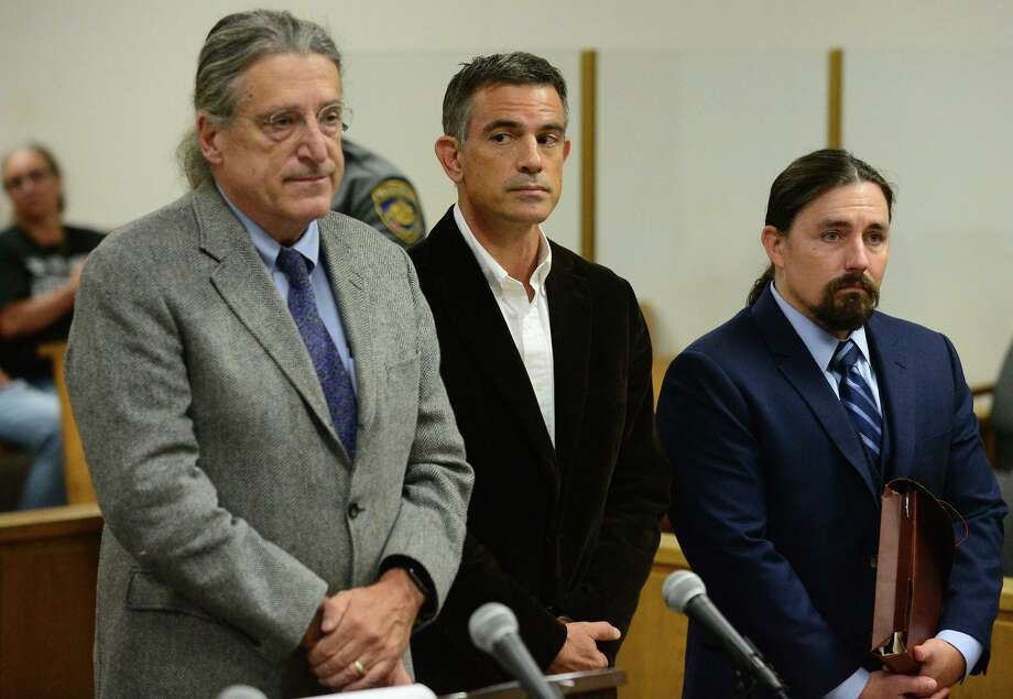 Fotis Dulos, center, appears with his attorneys Norm Pattis, left, and Kevin Smith, right, for arraignment on a new tampering with evidence charge Thursday, Sept. 12, 2019, at state Superior Court in Norwalk, Conn. Photo: Erik Trautmann / Hearst Connecticut Media / Norwalk Hour