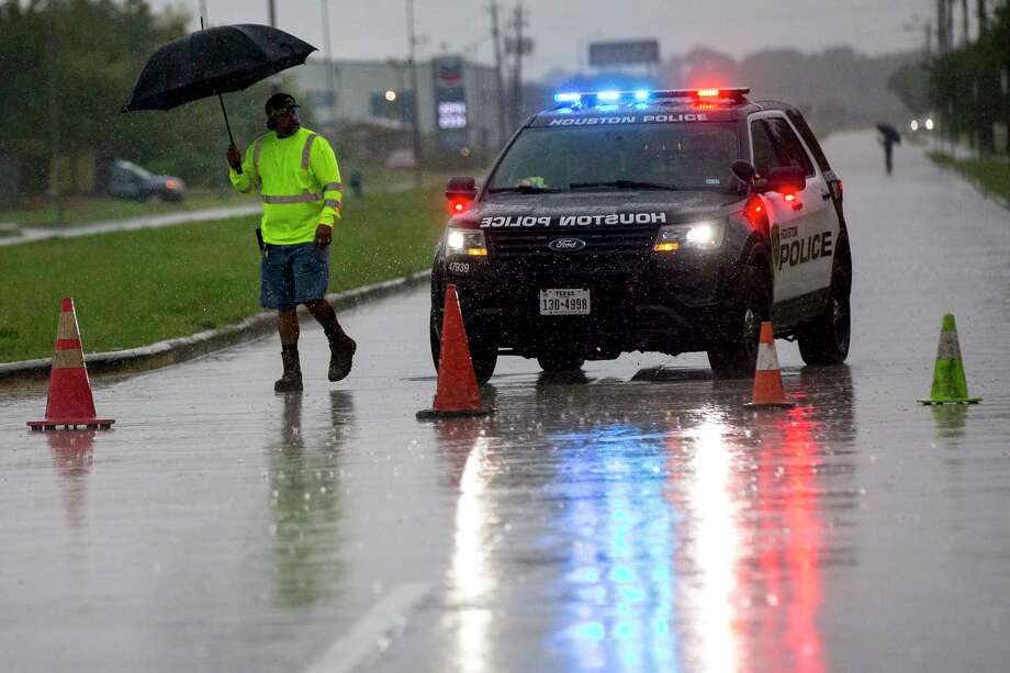 Police block Monroe Road near Hobby Airport after rain spawned by Tropical Storm Imelda, which dropped to a tropical depression overnight, caused flooding on Wednesday, Sept. 18, 2019, in Houston. Photo: Brett Coomer, Staff Photographer / © 2019 Houston Chronicle