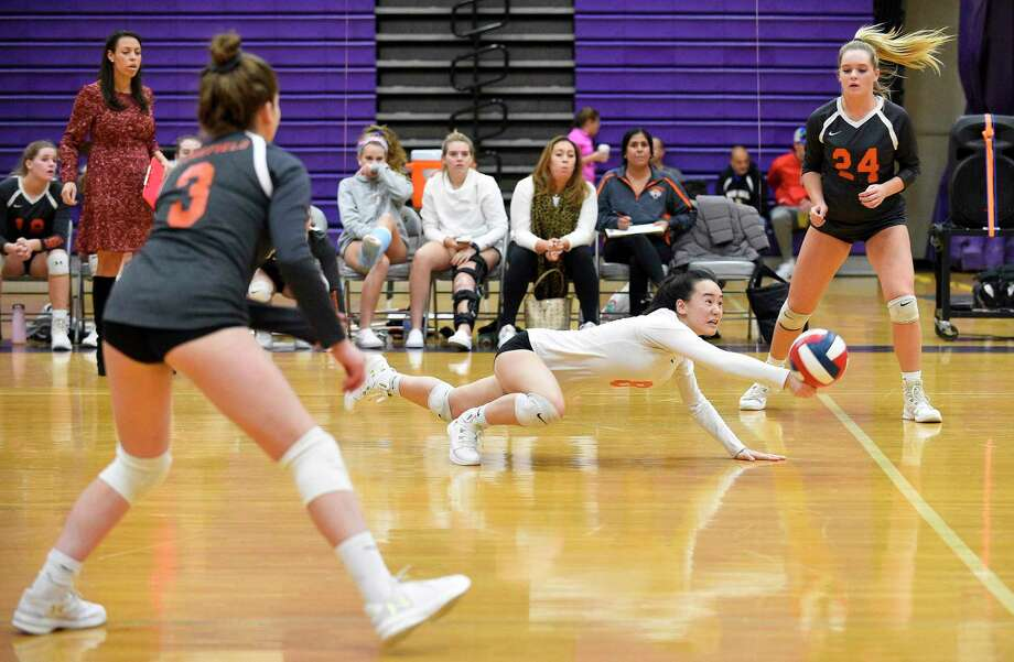 Ridgefield's Joyce Li (8) dives for the return in a varsity girls volleyball match against Westhill on Wednesday, Oct. 24, 2018 in Stamford, Connecticut. Westhill sweep Ridgefield in three sets (25-20, 25-11, 25-22) improving their record to 17-2 over all. Photo: Matthew Brown / Hearst Connecticut Media / Stamford Advocate