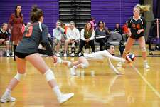 Ridgefield's Joyce Li (8) dives for the return in a varsity girls volleyball match against Westhill on Wednesday, Oct. 24, 2018 in Stamford, Connecticut. Westhill sweep Ridgefield in three sets (25-20, 25-11, 25-22) improving their record to 17-2 over all.