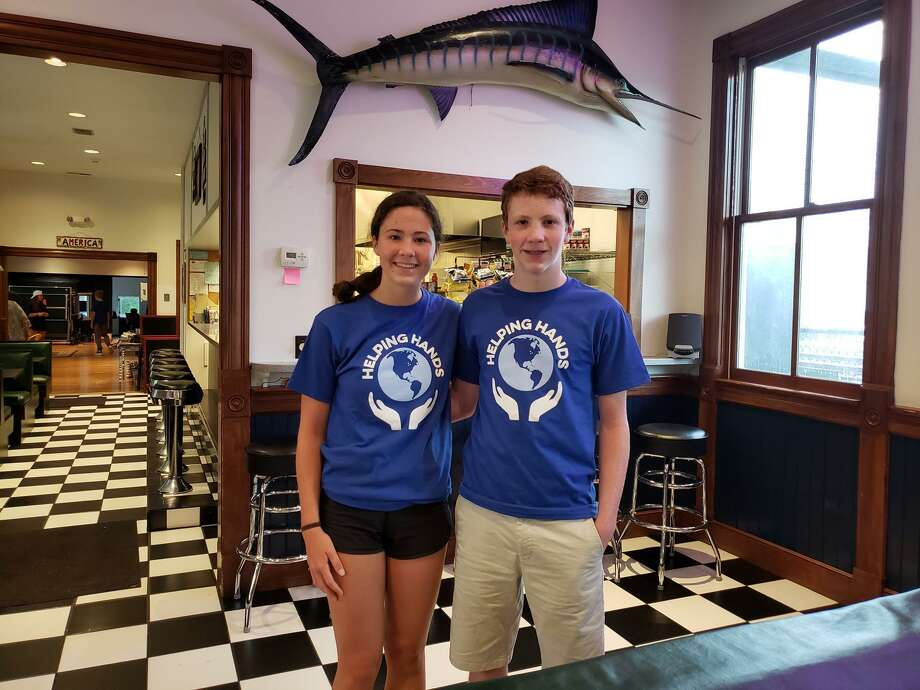 Kaitlyn and Andrew Popson of Darien are leading Helping Hands, a nonprofit organization that helps those in need. Photo: Sandra Diamond Fox / Hearst Connecticut Media / Connecticut Post