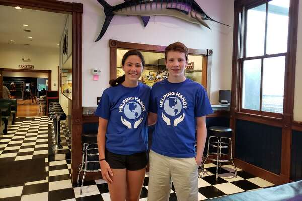 Kaitlyn and Andrew Popson of Darien are leading Helping Hands, a nonprofit organization that helps those in need.