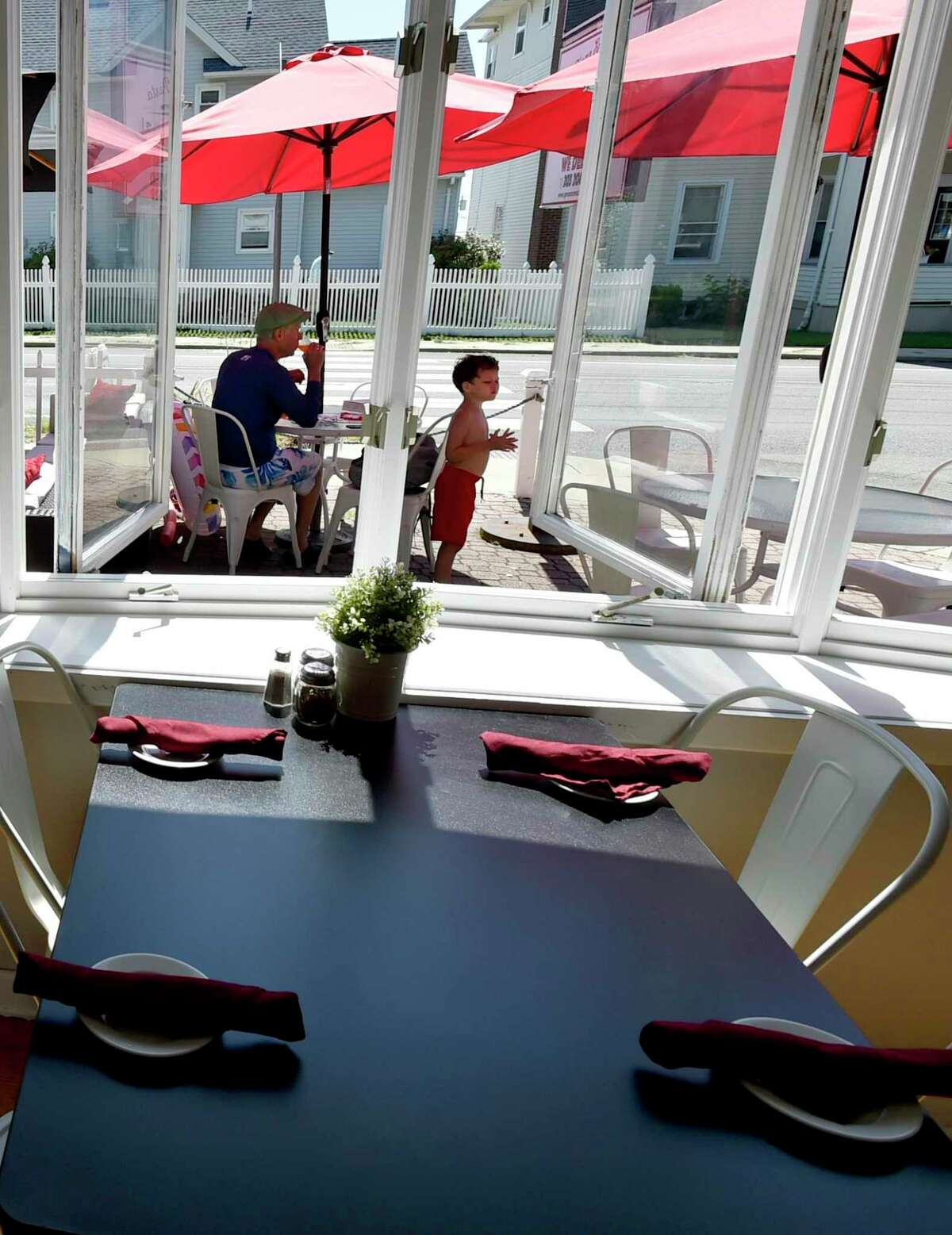Branford, Connecticut - Friday, August 30, 2019: Genaros Pizza & Pasta in Branford iocated next to the Short Beach post office, that offers pizza to pastas to seafood to sandwiches has an outdoor patio.