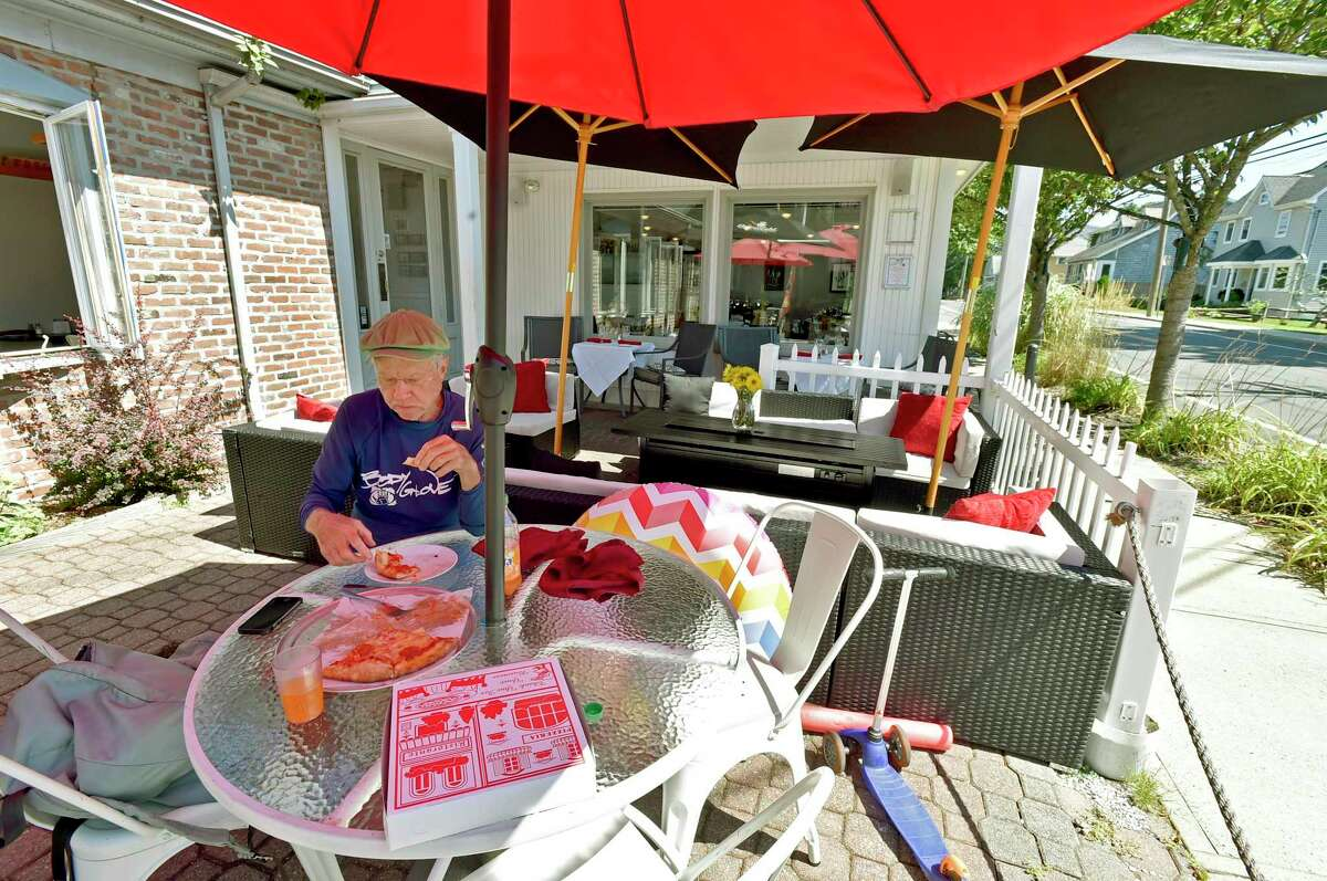 Gus Dudley of Guilford eating lunch on the outdoor patio at Genaros Pizza & Pasta in Branford iocated next to the Short Beach post office. The eatery offers pizza to pastas to seafood to sandwiches.