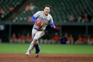 Toronto Blue Jays' Cavan Biggio runs to third base with a triple off Baltimore Orioles pitcher Mychal Givens during the ninth inning of a baseball game Tuesday, Sept. 17, 2019, in Baltimore. The Blue Jays won 8-5. (AP Photo/Julio Cortez)