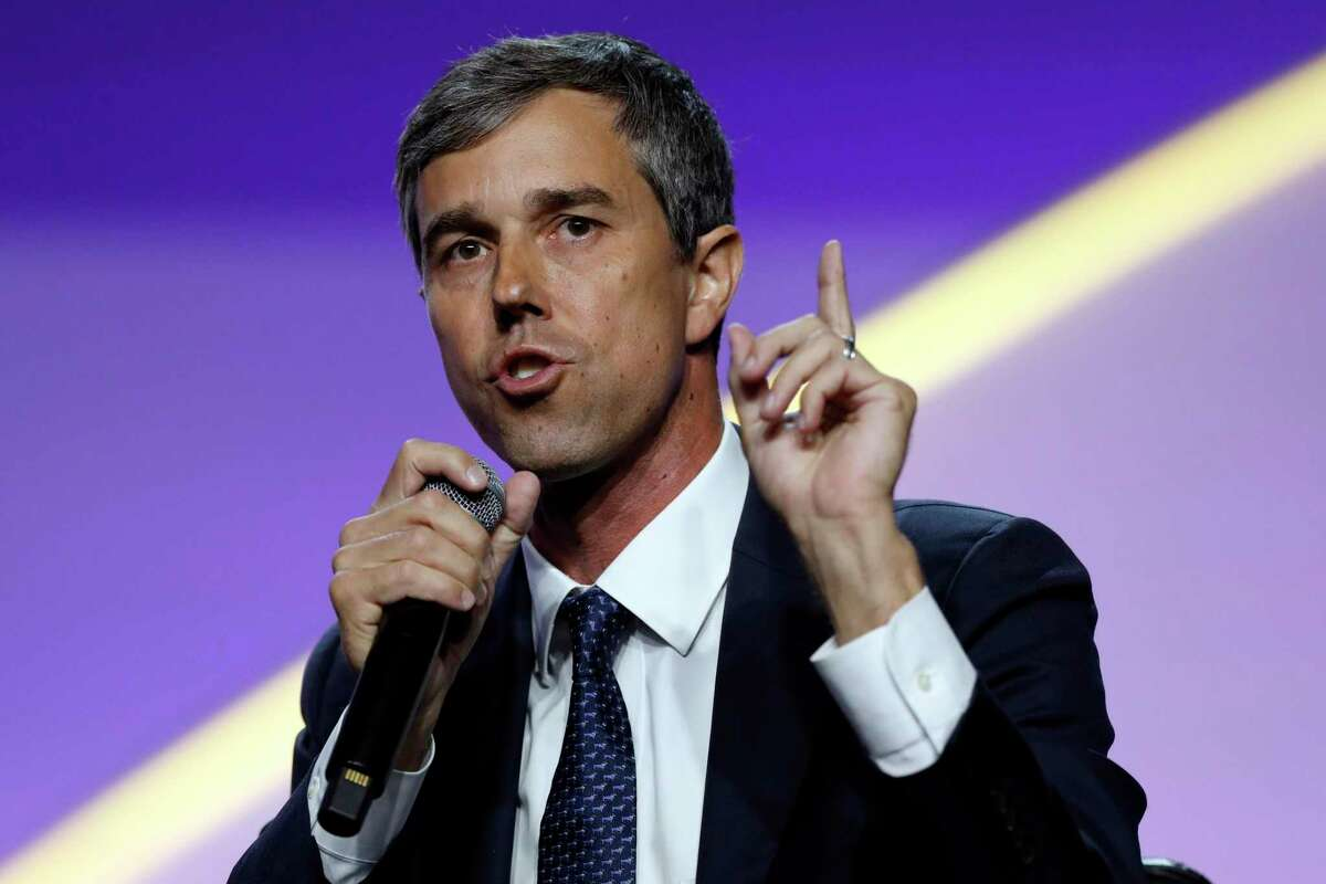 FILE - In this July 24, 2019, file photo, Democratic presidential candidate former Texas Rep. Beto O'Rourke, speaks during a candidates forum at the 110th NAACP National Convention in Detroit. As the U.S. economy flashes recession warning signs, Democratic presidential candidates are leveling pre-emptive blame on President Donald Trump. They argue that his aggressive and unpredictable tariff policies are to blame for gloomy economic forecasts. (AP Photo/Carlos Osorio)