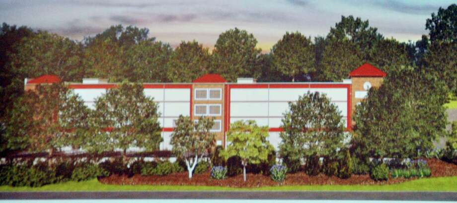 A storage facility proposed on Route 7 drew opposition from Haviland Road residents. One asked if the trees planted would be as tall as those shown in this rendering. Photo: Contributed / Hearts Connecticut Media