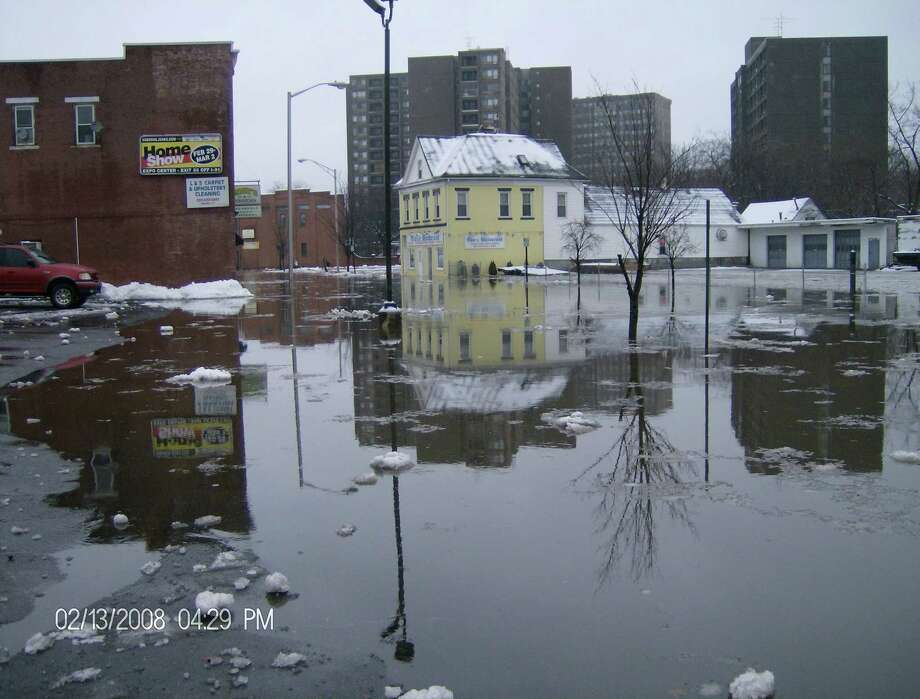 Floodwaters coursed through downtown Meriden streets in 2008 before the flood mitigation project. Photo: Meriden Department Of Public Works