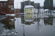 Floodwaters coursed through downtown Meriden streets in 2008 before the flood mitigation project.
