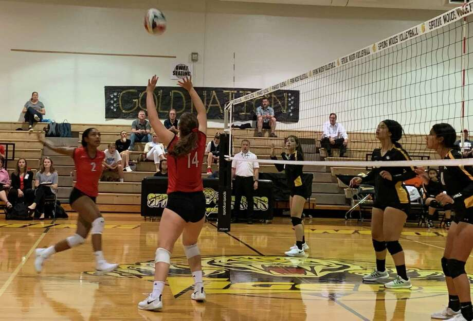 Memorial's Caroline Howell (14) sets a ball for Jada Gibson (2) during the Mustangs' sweep of Spring Woods, Sept. 17 at SWHS. Photo: Jack Marrion / Staff Photo