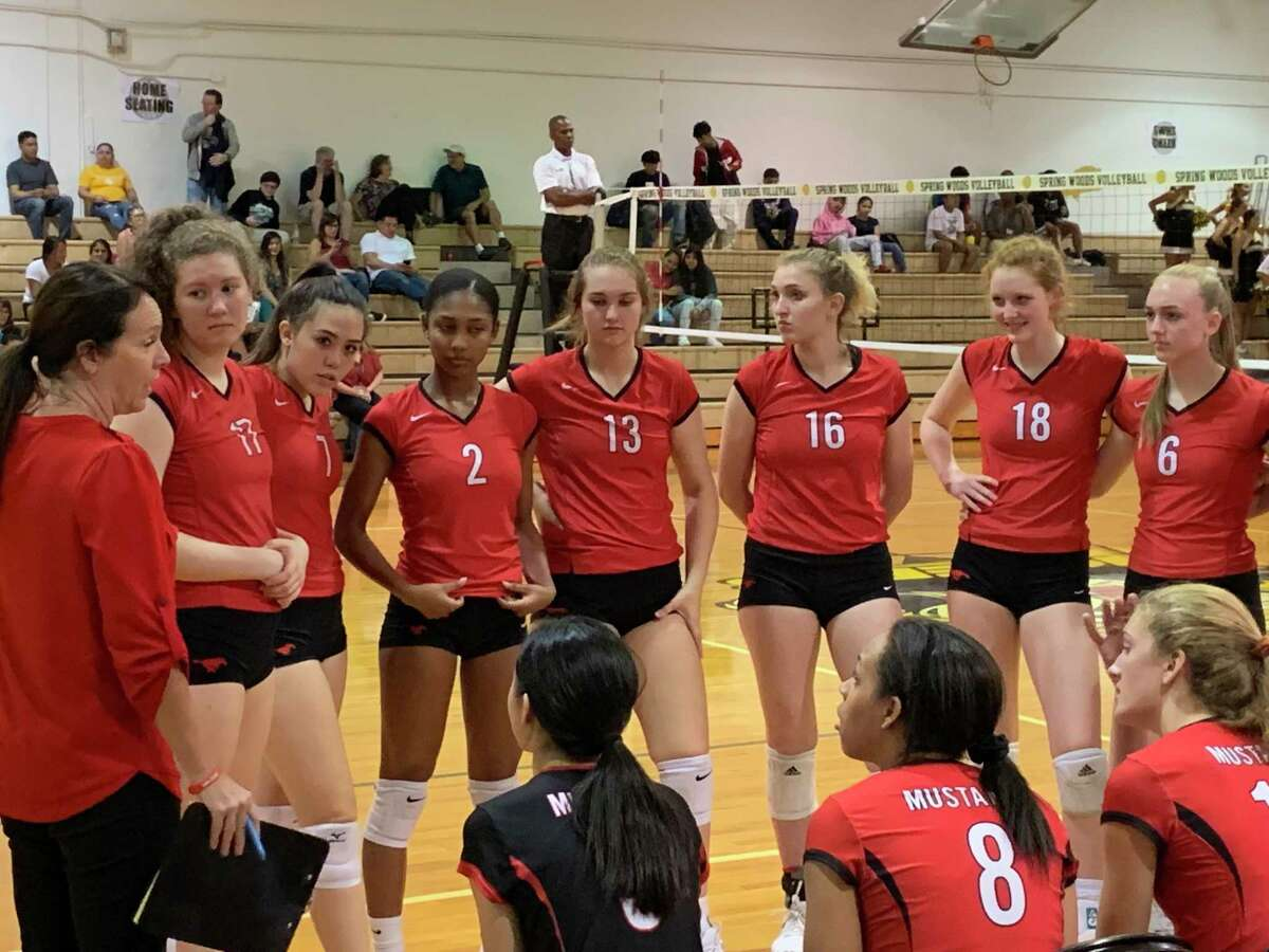Memorial coach Kaddie Platt talks to her team during a time out in their District 17-6A match at Spring Woods. Platt is in her first season as a high school head coach after more than 20 years in college.