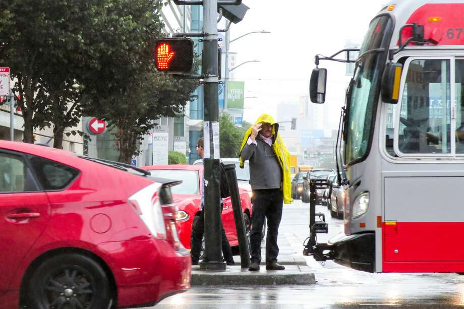 Morning commuters deal with the second light rainfall of the week in downtown San Francisco on Sept. 18, 2019. Photo: Douglas Zimmerman / SFGate