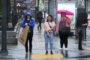 Morning commuters deal with the second light rainfall of the week in downtown San Francisco on Sept. 18, 2019.