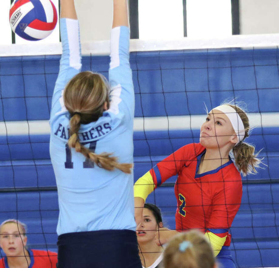 Roxana's Reagen Stahlhut (right) scores on a hit past the block of Jersey's Boston Talley in a match last month in Roxana. On Tuesday, Stahlhut had eight kills in the Shells' three-set victory over the rival Oilers in Wood River. Photo: Greg Shashack / The Telegraph