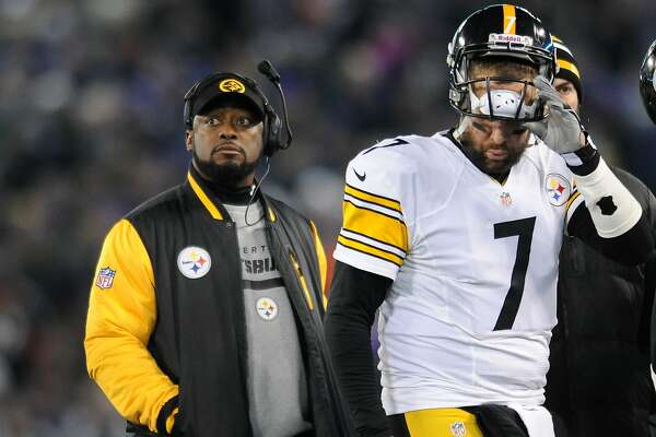 Pittsburgh Steelers head coach Mike Tomlin stands on the sideline as quarterback Ben Roethlisberger walks off the field in the second half of an NFL football game against the Baltimore Ravens, Thursday, Nov. 28, 2013, in Baltimore. (AP Photo/Gail Burton)