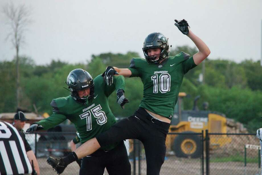 Lutheran South Academy's Lane Whitney (75) and Jake Justice (10) celebrate a touchdown against Beaumont Legacy Christian last week. The Pioneers host Brookshire Royal this Friday. Photo: Kirk Sides / Staff Photographer / © 2019 Kirk Sides / Houston Chronicle