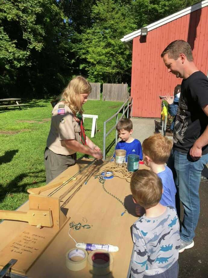 Troop 53 Scout Wade Flaherty shows the ropes to potential Cub Scouts. Photo: Darien Scouts