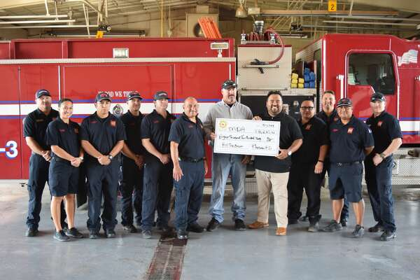 Local firefighters present a check from Fill The Boot proceeds to MDA West Texas. Pictured: Firefighters Matt Blackburn, Katalina Jerden, Arnulfo Hernandez, Cameron Lunsford, Clay Elliott, Gilbert Nunez and Kevin Goss, DJ Perez, with MDA West Texas, and firefighters Harrison Hart, Jesse Edwards, TJ Marquez and Travis Zumwalt