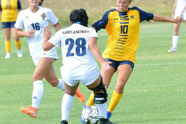 Wayland Baptist middle fielder Natalie Terry takes the ball past Howard Payne defenders Marisah Mata (16) and Alexis Sanchez during a non-conference soccer match on Tuesday at J.V. Hilliard Field.