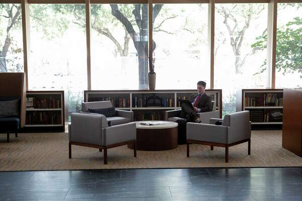 A man sits in the lobby lounge in the new Frost Tower Building downtown. The lobby houses an operating branch of Frost Bank.