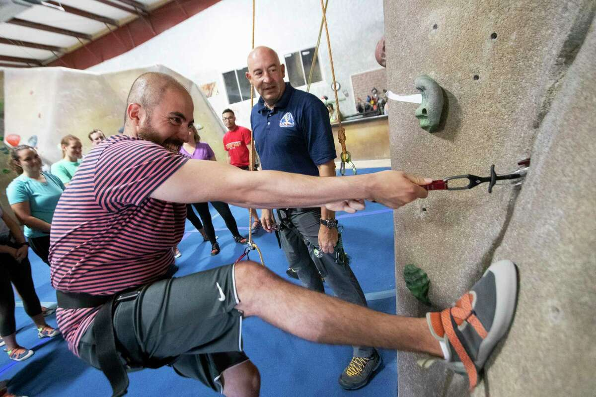 University of Texas Medical Branch second year medical student Omar Abdelaziz, 23, learns about rock climbing during a class at the Space City Rock Climbing Center.