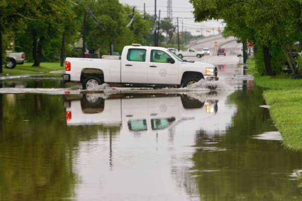 A vehicle drives across a flooded S. Velasco Blvd. between west Fifth and Seventh streets in Freeport, TX, Wednesday, Sept. 18, 2019. According to Freeport police, impacts on homes have been minimal so far with one of the main problems being people driving too fast through water and pushing the flooding into houses with their wake.