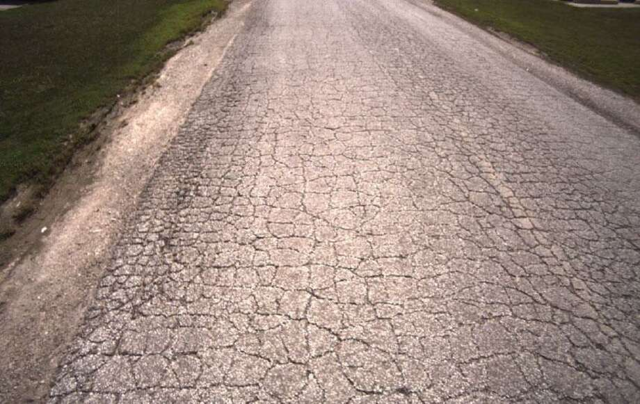 Example of a cracking road in very poor condition. (From Street Scan, road not in Wilton) Photo: Contributed /