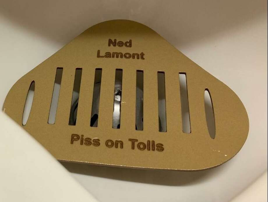 "Urinal screens with the words ""Ned Lamont — Piss on Tolls"" were found at the Legislative Office Building Photo: Courtesy WTNH / Courtesy WTNH"