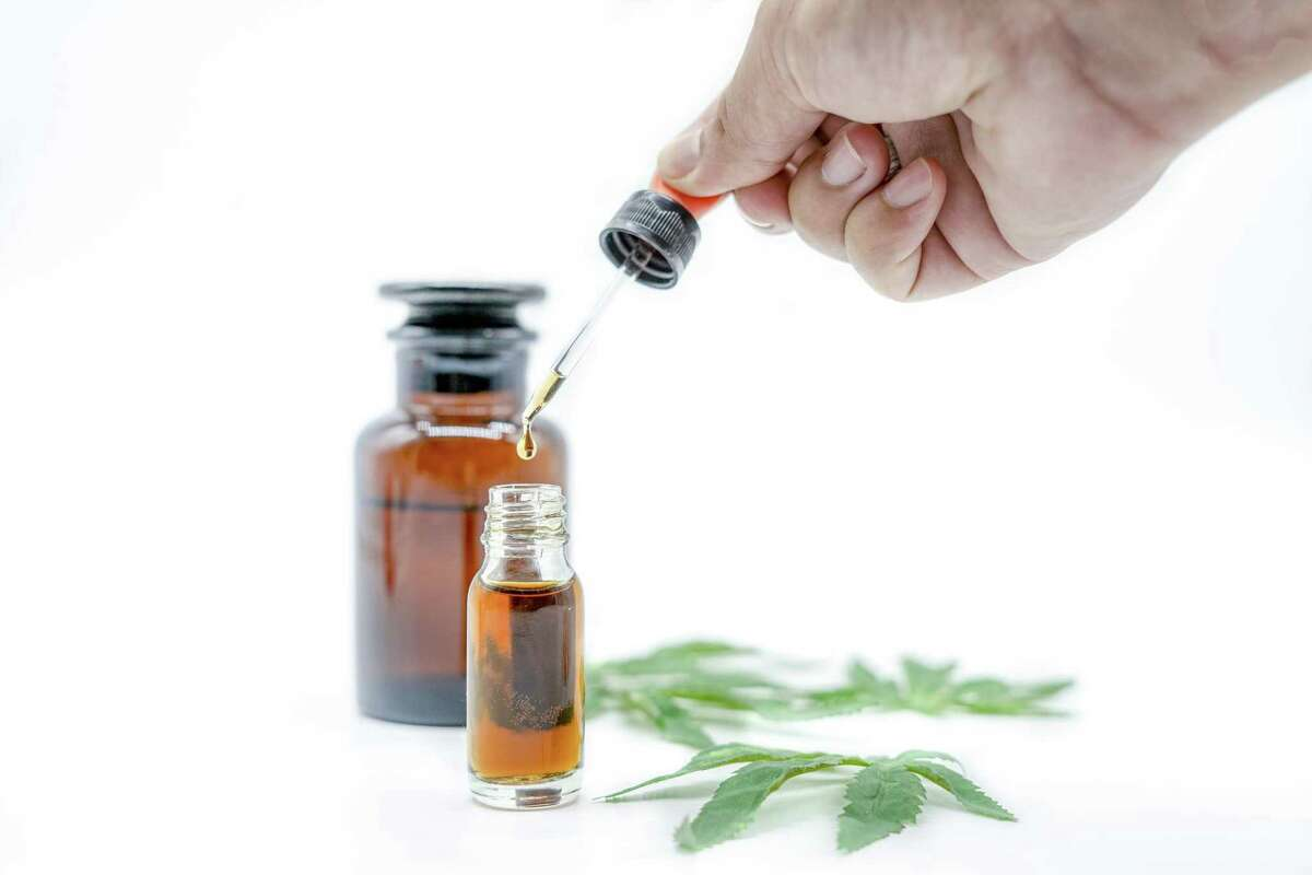 A bottle of Cannabis oil in, natural herb, medical marijuana concept, CBD cannabis OIL. hemp product, close up,