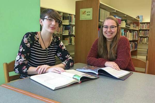 Chelsie Labrecque and Zanny Stowell have been surprised by the demand for the library system's Dungeons & Dragons clubs.
