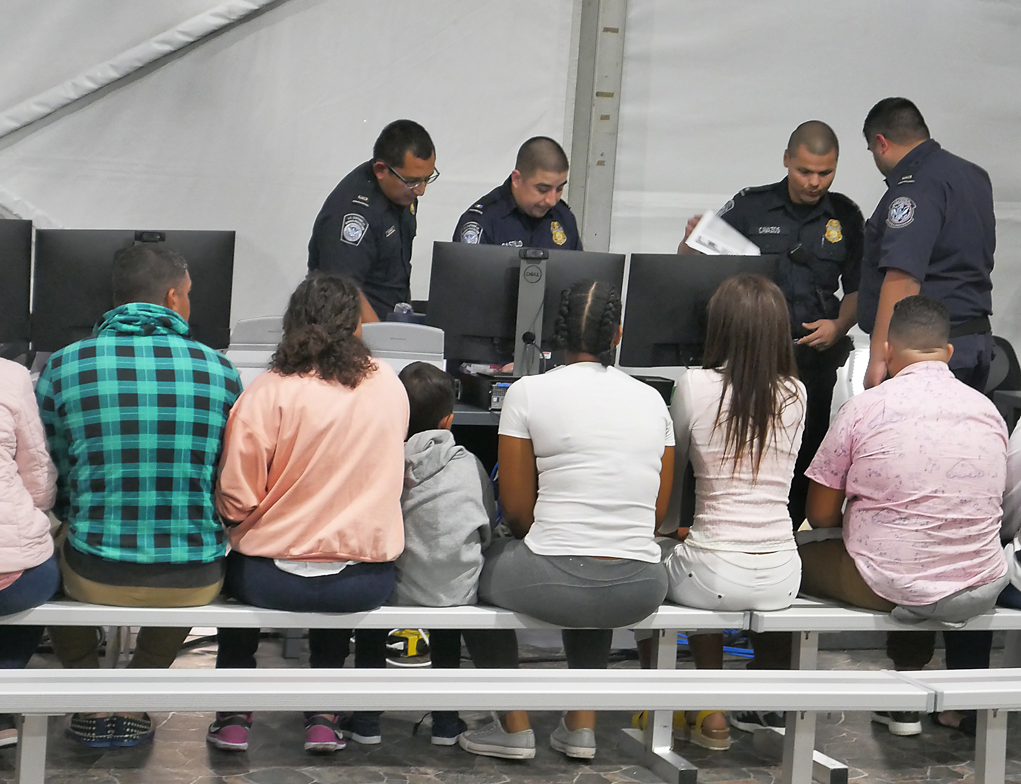 Migrants in fear, await fate as officials tour migrant facility in Laredo