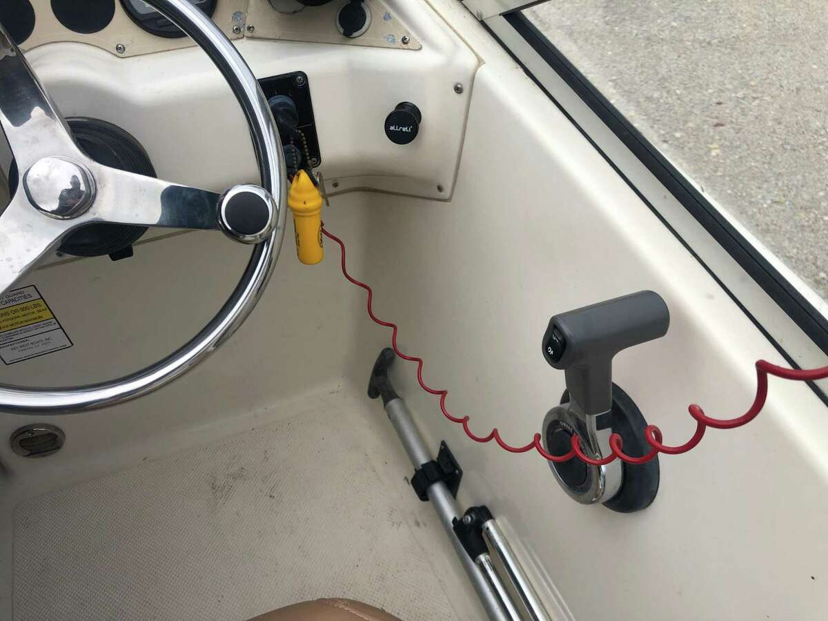 An emergency cut-off switch device that shuts off a boat's engine if the driver is thrown off is seen on a Montgomery County Precinct 1 Constable's marine division patrol boat.