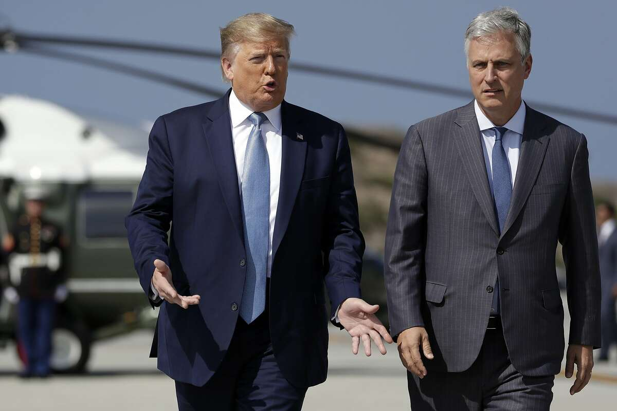 President Donald Trump and Robert O'Brien, just named as the new national security adviser, walk to speak to the media at Los Angeles International Airport, Wednesday, Sept. 18, 2019, in Los Angeles. (AP Photo/Evan Vucci)