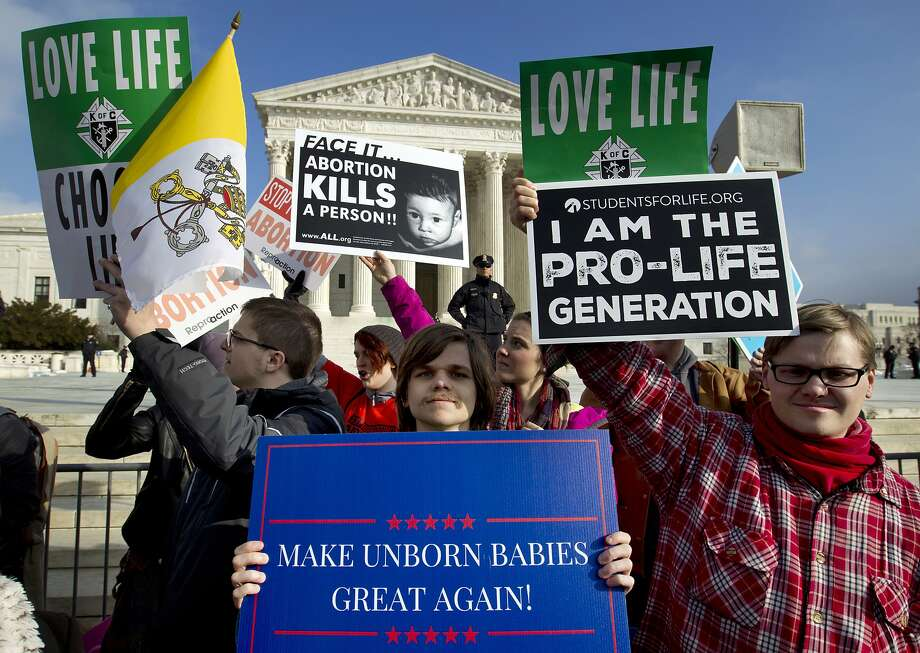 FILE - In this Jan. 18, 2019, file photo, anti-abortion activists protest outside of the U.S. Supreme Court, during the March for Life in Washington. The number and rate of abortions across the United States have plunged to their lowest levels since the procedure became legal nationwide in 1973, according to new figures released Wednesday, Sept. 18.  (AP Photo/Jose Luis Magana, File) Photo: Jose Luis Magana, Associated Press