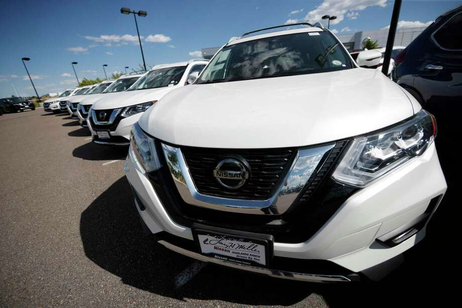 In this Sunday, Aug. 25, 2019, photograph, unsold Rogue sports-utility vehicles sit at a Nissan dealership in Highlands Ranch, Colo. >>>PHOTOS: See which new cars Houstonians keep the longest... Photo: David Zalubowski, STF / Associated Press / Copyright 2019 The Associated Press. All rights reserved.