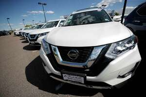 In this Sunday, Aug. 25, 2019, photograph, unsold Rogue sports-utility vehicles sit at a Nissan dealership in Highlands Ranch, Colo. (AP Photo/David Zalubowski)