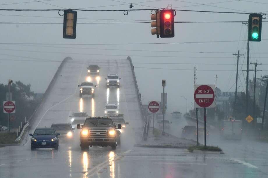 Traffic crosses the Cow Bayou Bridge on Texas 73 in Bridge City during Wednesday's rain showers.  Photo taken Wednesday, 9/18/19 Photo: Guiseppe Barranco/The Enterprise