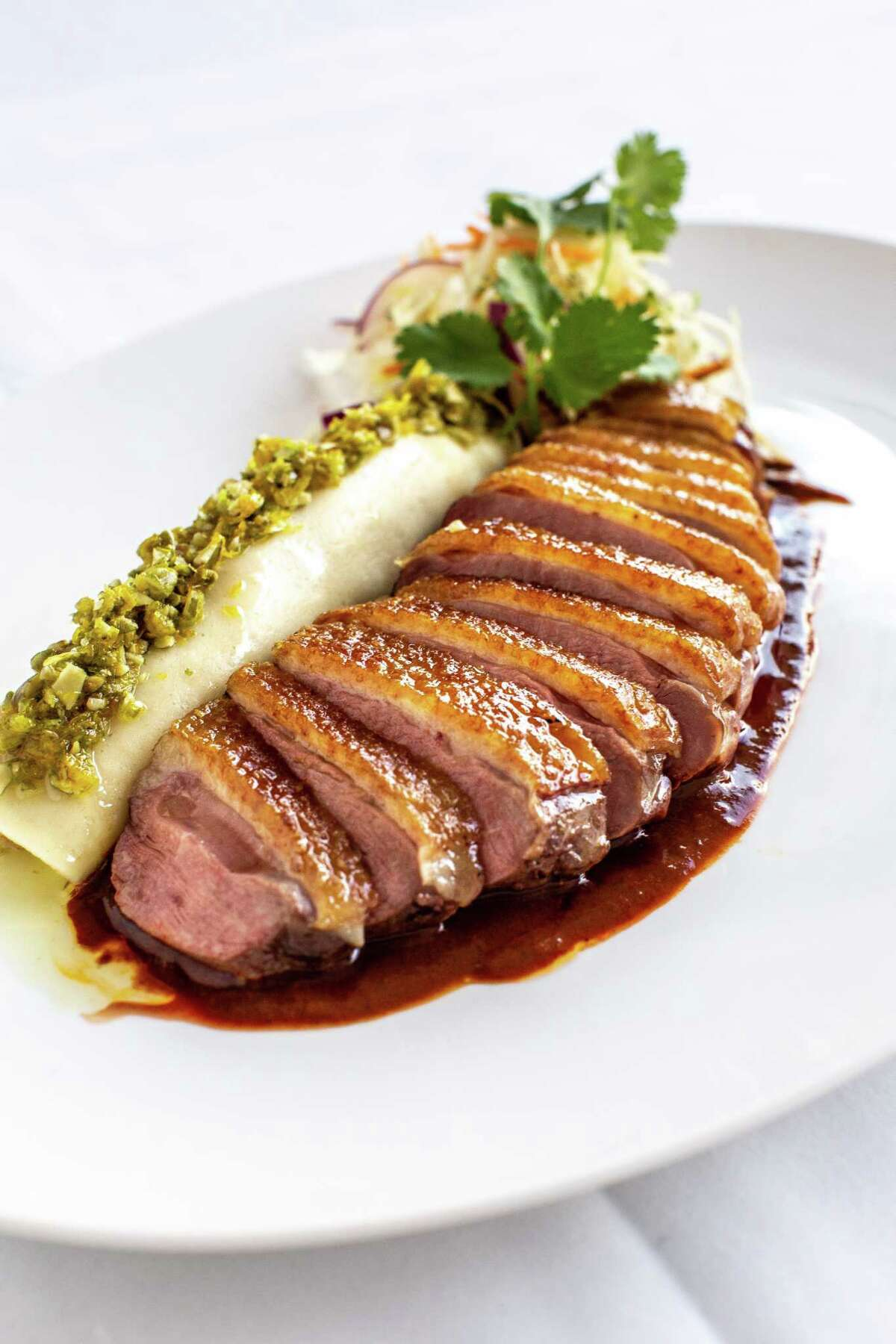 Roasted duck breast with cocoa mole at The Annie Cafe & Bar, a new era for the former Cafe Annie opening Sept. 24 at 1800 Post Oak.