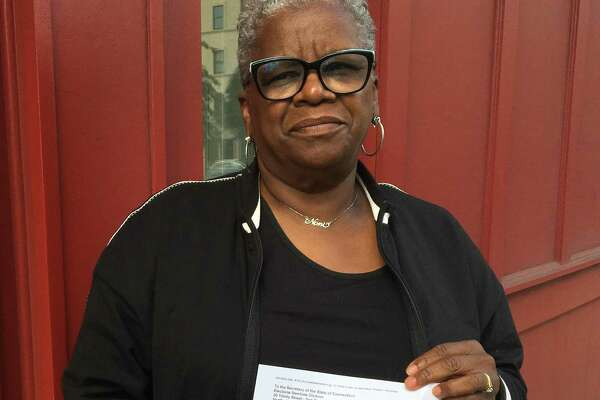 Bridgeport mayoral challenger Marilyn Moore and the write-in document that was delivered Wednesday to the Secretary of the State.