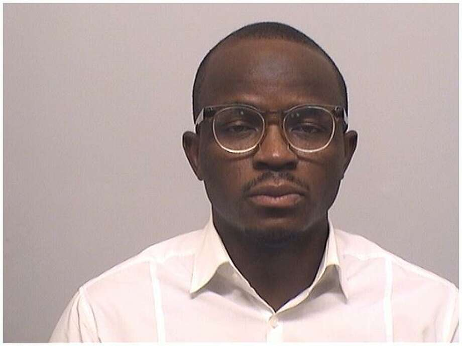Tolulope Rahman Salam, 34, of Atlanta, Georgia, was charged with first-degree larceny for helping a woman cash $21,000 in counterfeit checks from a Stamford construction company, police said. Photo: Stamford Police Department / Contributed