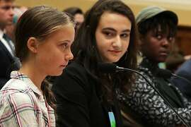 WASHINGTON, DC - SEPTEMBER 18:  (L-R) Founder of Fridays For Future Greta Thunberg, co-founder of This Is Zero Hour, and plaintiff in Piper v. State of Washington Jamie Margolin, and fellow for the Alliance for Climate Education, and plaintiff in Juliana v. United States Vic Barrett, testify during a House Foreign Affairs Committee Europe, Eurasia, Energy and the Environment Subcommittee and House (Select) Climate Crisis Committee joint hearing September 18, 2019 on Capitol Hill in Washington, DC. Thunberg, who recently sailed across the Atlantic Ocean in a zero-carbon emissions sailboat, is in Washington to discuss the climate crisis with lawmakers and will speak at the UN Climate Action Summit on September 23 in New York.  (Photo by Alex Wong/Getty Images)