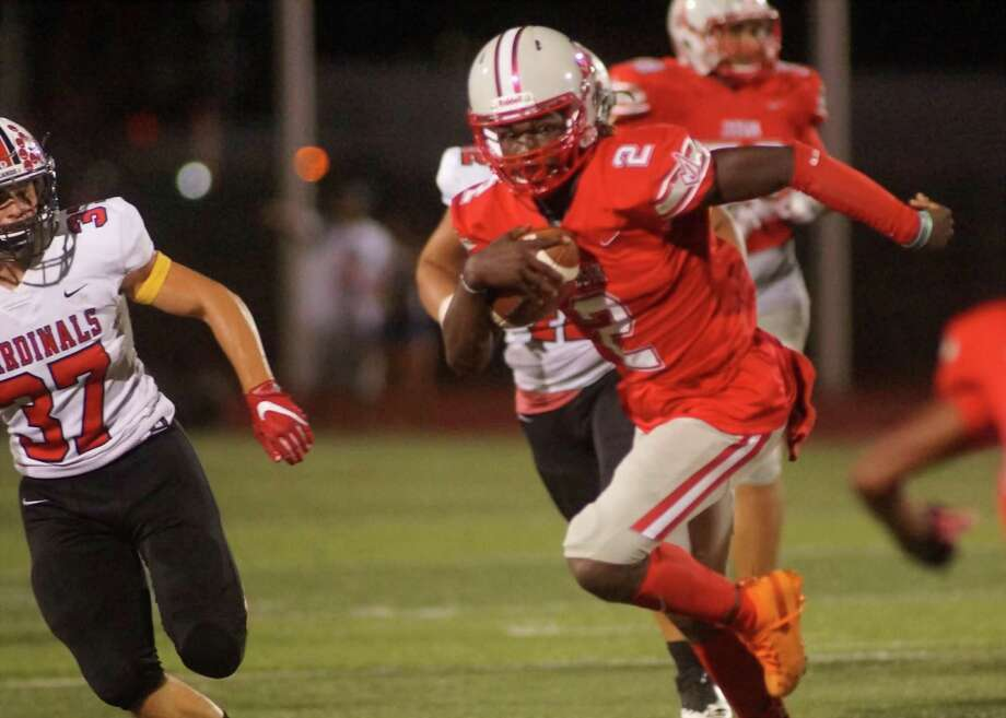 Judson quarterback Mike Chandler II finds running room outside early in the third quarter of the Rockets' 39-0 thrashing of the Harlingen Cardinals Fridayat Rutledge Stadium. Photo: Lavon Brown /Contributor