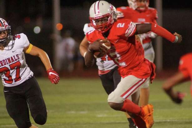 Judson quarterback Mike Chandler II finds running room outside early in the third quarter of the Rockets' 39-0 thrashing of the Harlingen Cardinals Fridayat Rutledge Stadium.
