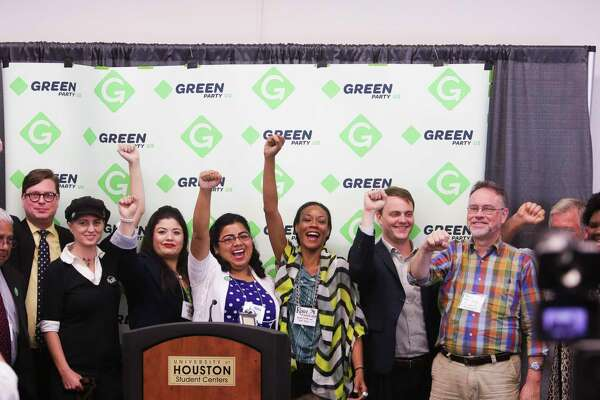 Green Party candidates from Texas and across the country hold up their fists after speaking at a press conference at the Green Party Convention at the University of Houston Friday, August 5, 2016 in Houston. ( Michael Ciaglo / Houston Chronicle )