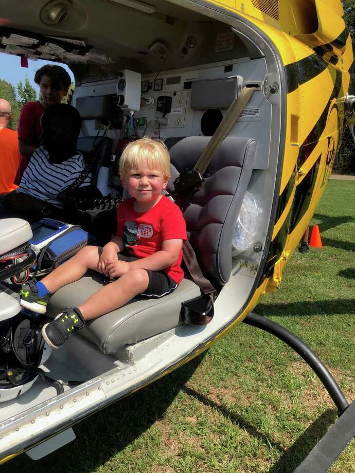 Youngsters explored the inside of a PHI Medical Helicopter on Sept. 14 at the Conroe Noon Kiwanis Club's Kids Day at the Park. Pictured is Rylan Duke, 2 years old. His parents are Matt and Lindsay Duke. Photo: Courtesy Photo