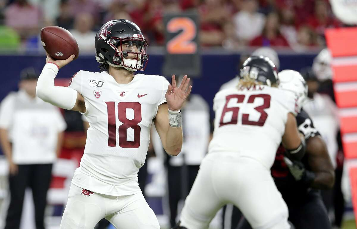 Washington State Cougars quarterback Anthony Gordon (18) throws a pass as offensive lineman Liam Ryan (63) blocks during the first half of an NCAA college football game against the Houston Cougars Friday, Sept. 13, 2019, in Houston. (AP Photo/Michael Wyke)
