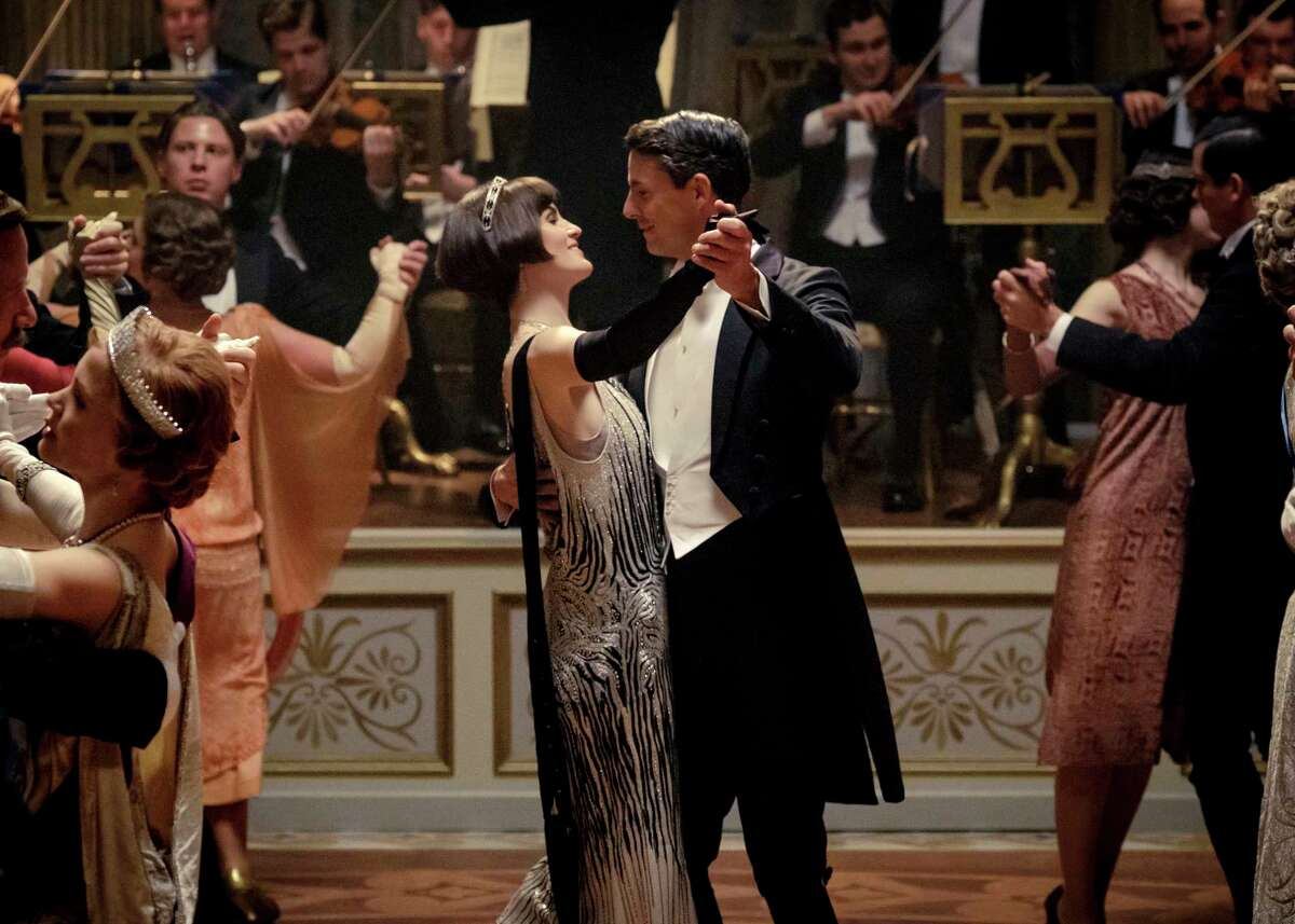 This image released by Focus features shows Michelle Dockery as Lady Mary Talbot, center left, and Matthew Goode as Henry Talbot in a scene from